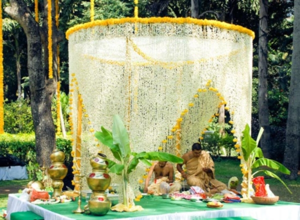 Significance of auspicious flowers in indian weddings for Artificial flower decoration mandap