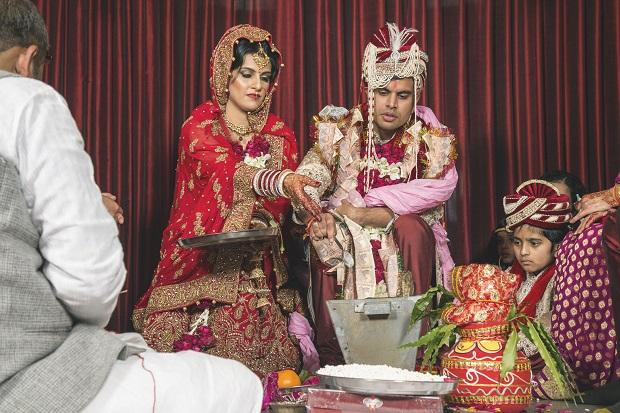 red lehenga real bride Gurgaon Leela Kempinski