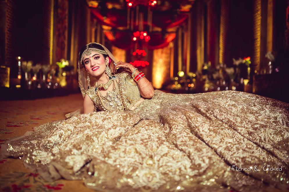 bridal lehenga by Harpreet and Rimple Narula-golden beige ivory lehenga