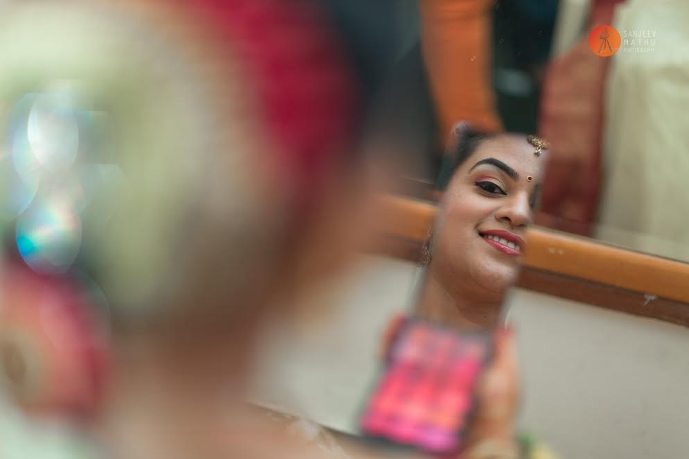 bride getting ready-bride and groom real wedding by Sanjeev Mathu photography