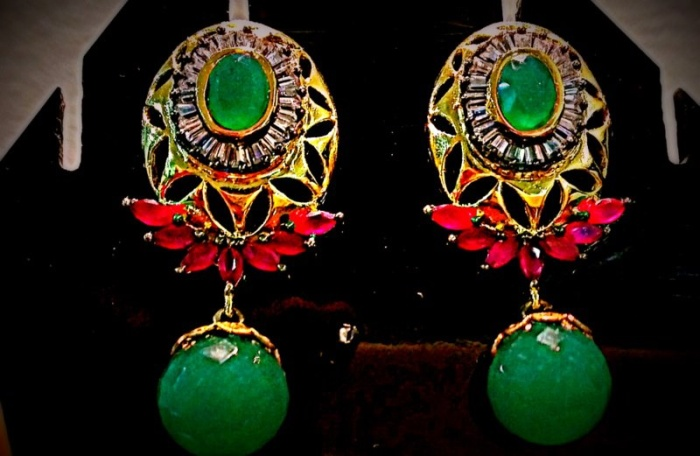 emerald-ruby and zircons gold plated inr 3500