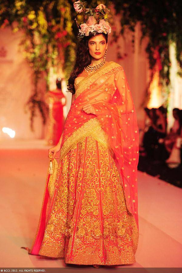 Indrani-Dasgupta-flaunts-a-creation-by-designers-Falguni-and-Shane-Peacock-on-Day-3-of-the-India-Bridal-Fashion-Week-IBFW-2013-at-The-Grand-Vasant-Kunj-in-New-Delhi