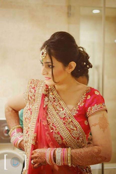 honey-comb bun-Wedding hairstyles for the Indian bride