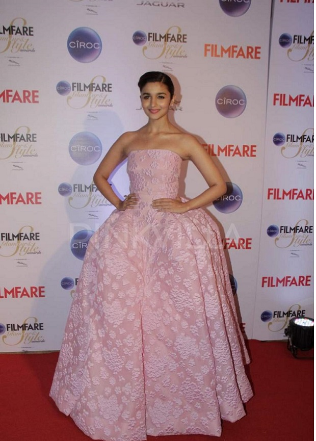 Alia Bhatt at the Kareena Kapoor was voted the most stylish as she showcased her hourglass figure in a studded yellow Roberto Cavalli gown. The event we are talking about is The Ciroc Filmfare Glamour and Style Award show which was recently held in Mumbai at The Taj Land's End Hotel.  Alia Bhatt (who is often compared to Kareena, we hear) looked like a cute Disney Princess in her pink ball gown. (Alia Bhatt was nominated in the Emerging Face of Fashion (female) category and took home the trophy beating others including newcomers Illeana D'Cruz, Shraddha Kapoor etc. Pinks, peach and shades of red seemed to be the popular colours of the evening with many ladies choosing gowns in these shades. Sonam, who is a regular on the red carpet these days, chose an off-shoulder asymmetric red gown with an interesting silhouette that was enhanced by the multicoloured stripes at the bottom up front. We also loved Nargis's colour of choice for the evening and her nude pumps are certainly steal worthy for our brides, we think. Sunny Leone and yesteryears beauty Neelam (we almost didn't recognize her there!) looked glamorous in black. Brides to be can of course opt for Shruti Hasan's braided up do but we are not too fond of her dress there. Jacqueline gets full marks in out books for keeping things classy and elegant in a dramatic off-shoulder asymmetric black gown with a figure-hugging silhouette. Do comment below as to who was the best and worst dressed celeb from the Filmfare Glamour and Style Award 2015.