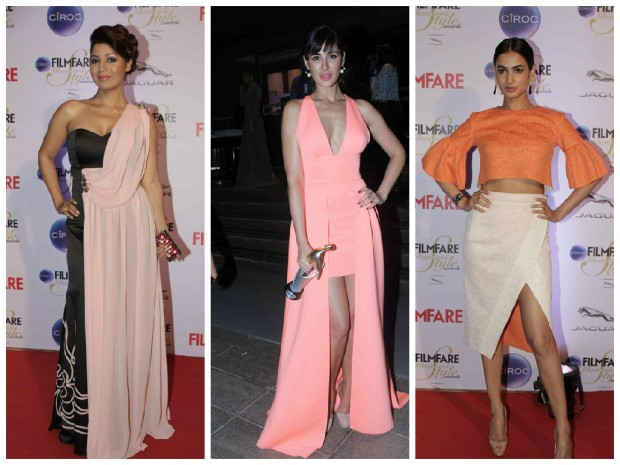 Nargis Fakhri at Kareena Kapoor was voted the most stylish as she showcased her hourglass figure in a studded yellow Roberto Cavalli gown. The event we are talking about is The Ciroc Filmfare Glamour and Style Award show which was recently held in Mumbai at The Taj Land's End Hotel.  Alia Bhatt (who is often compared to Kareena, we hear) looked like a cute Disney Princess in her pink ball gown. (Alia Bhatt was nominated in the Emerging Face of Fashion (female) category and took home the trophy beating others including newcomers Illeana D'Cruz, Shraddha Kapoor etc. Pinks, peach and shades of red seemed to be the popular colours of the evening with many ladies choosing gowns in these shades. Sonam, who is a regular on the red carpet these days, chose an off-shoulder asymmetric red gown with an interesting silhouette that was enhanced by the multicoloured stripes at the bottom up front. We also loved Nargis's colour of choice for the evening and her nude pumps are certainly steal worthy for our brides, we think. Sunny Leone and yesteryears beauty Neelam (we almost didn't recognize her there!) looked glamorous in black. Brides to be can of course opt for Shruti Hasan's braided up do but we are not too fond of her dress there. Jacqueline gets full marks in out books for keeping things classy and elegant in a dramatic off-shoulder asymmetric black gown with a figure-hugging silhouette. Do comment below as to who was the best and worst dressed celeb from the Filmfare Glamour and Style Award 2015.