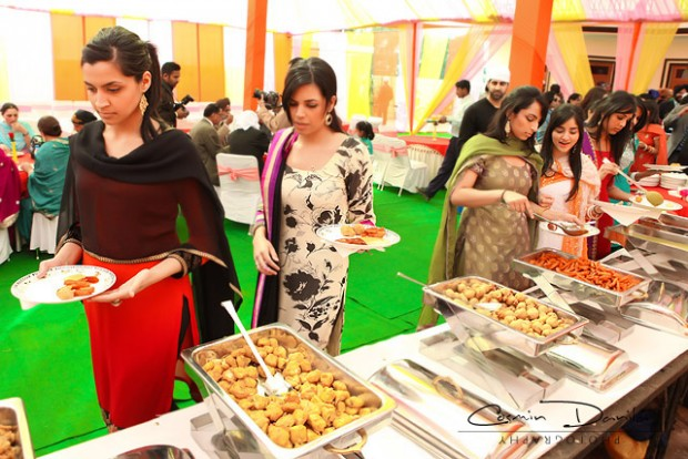 guests at Indian wedding eating delicious food-Indian wedding catering