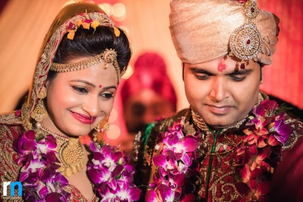 beautiful red and gold themed real wedding in Varanasi