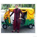 Groom arrives in an autorikshaw for his Baraat