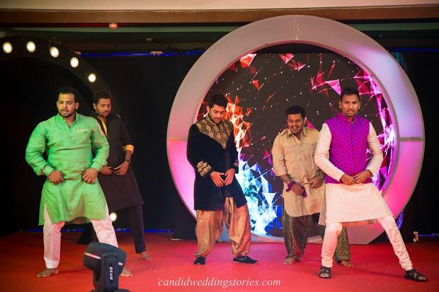 Indian baraatis dancing at Bollywood themed destination Goa wedding