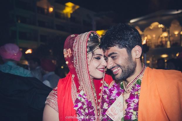 Bollywood themed destination Goa wedding- red Lehenga orange sherwani