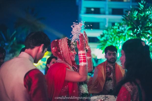 bride throws rice at her Bollywood themed destination Goa wedding