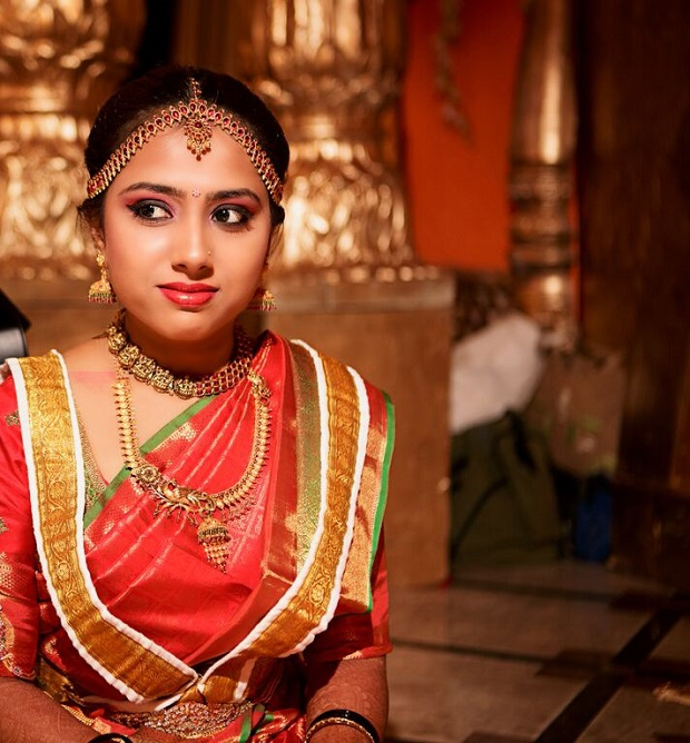 traditional South Indian bridal makeup orange and gold wedding theme