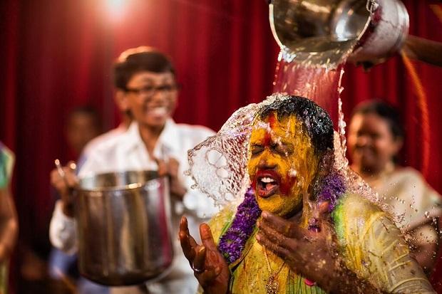 groom getting haldi bath