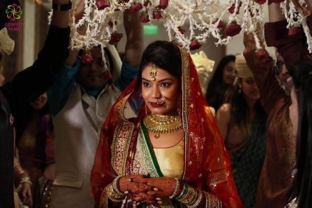 Red golden wedding lehenga Indian real weddings