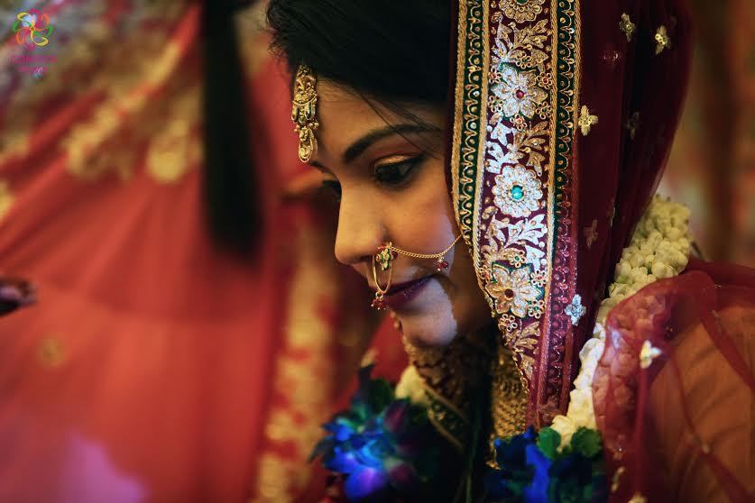 Beautiful Indian bride in red gold lehenga choli with zari border