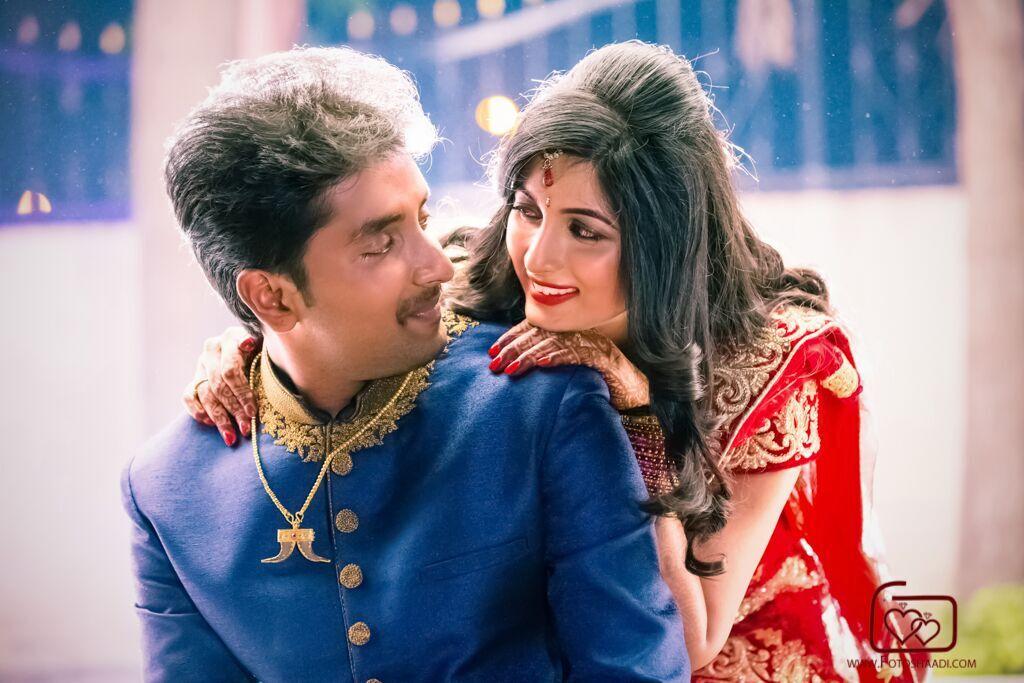 bride red sari and groom blue sherwani real wedding in India