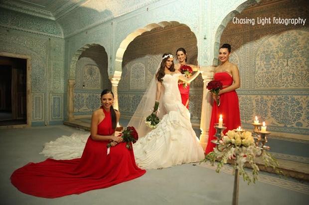 red bridesmaid dresses-real Indian wedding-Samode palace wedding Jaipur