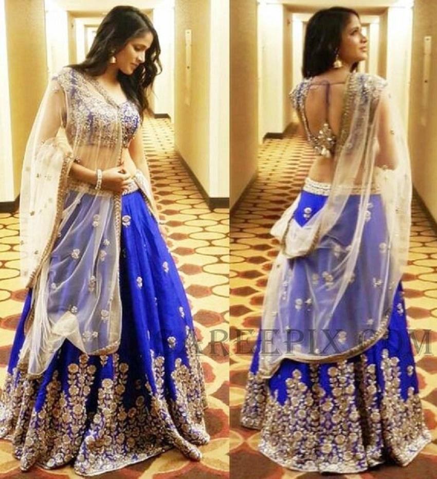 sleeveless wedding lehenga in blue and beige gold by mrunalini rao