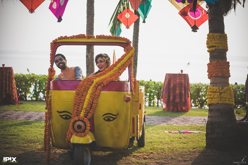 bride and groom in a decorated rickshaw Cineyug Celebrations wedding planners