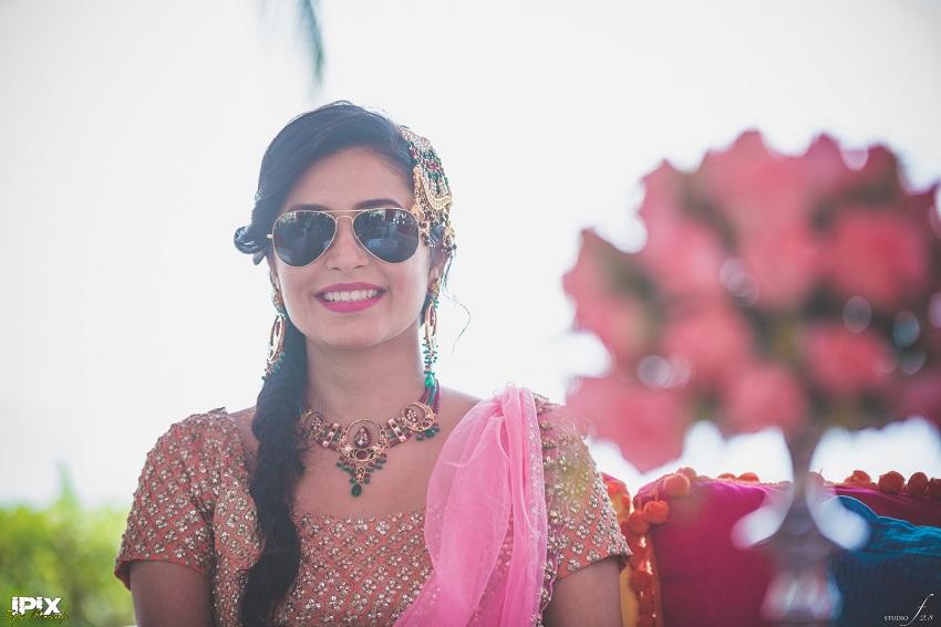 Pink floral lehenga Mehendi ceremony in Grand Hyatt Goa
