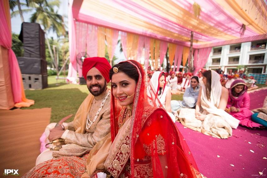 bride and groom red lehenga beautiful Sikh wedding in Grand Hyatt Goa