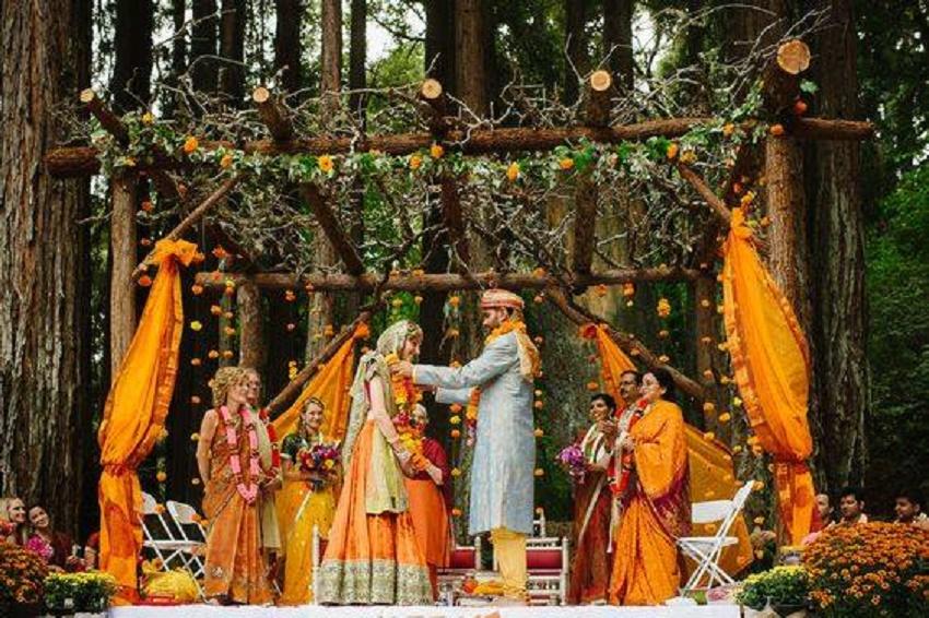 beautiful orange gold themed wedding by Xenia Hospitality LLP