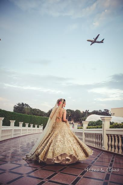 stylized concept shoot with golden lehenga by Rimple and Harpreet Narula
