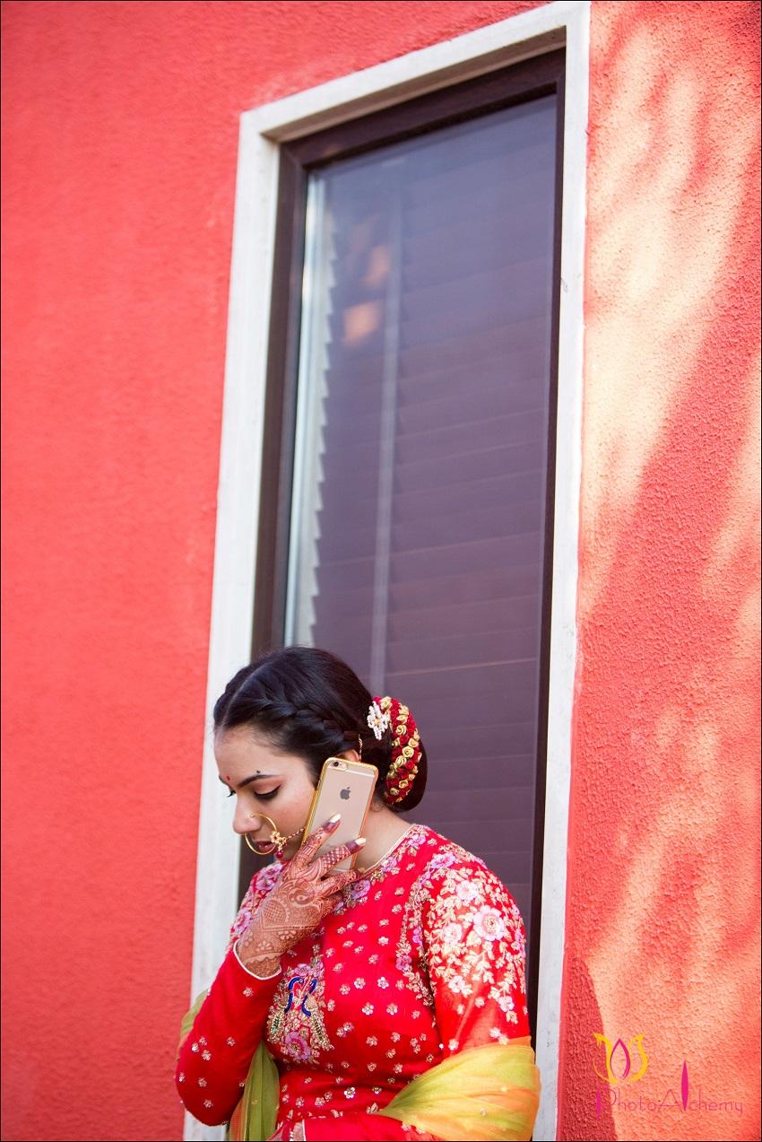 bride talking on phone-fusion Marwari Tamil destination wedding in Goa