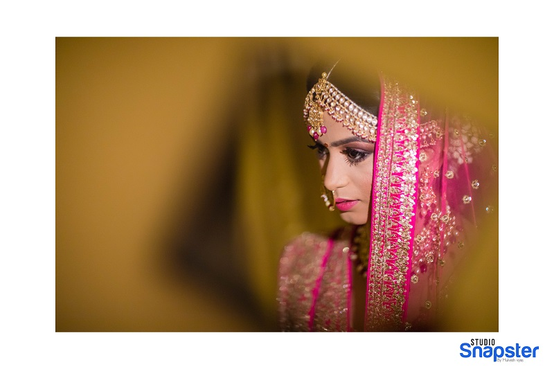 pink lehenga real wedding beautiful bridal hairstyle Indian real wedding by Studio Snapster Raipur