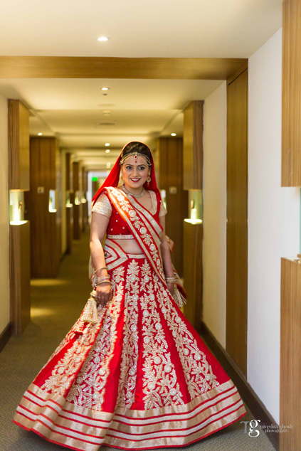 red lehenga Nivedita Ghosh Photography real wedding at Club Millennium Juhu