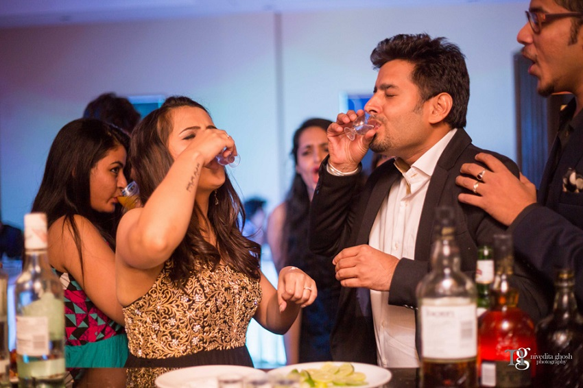 bride takes a Tequila shot Nivedita Ghosh Photography real wedding at Club Millennium Juhu