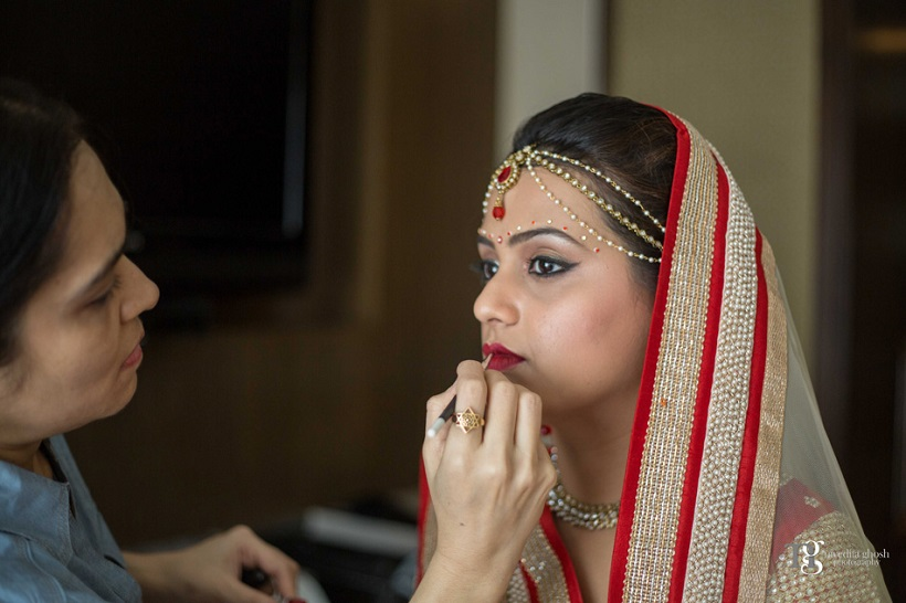 bride gets made up at her bride at her wedding Club Millennium by Nivedita Ghosh Photography