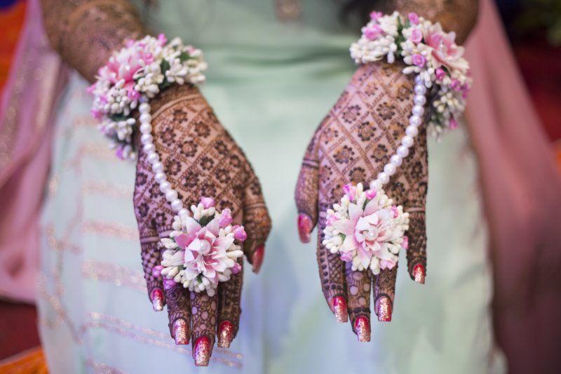 mehendi hands and floral jewelry