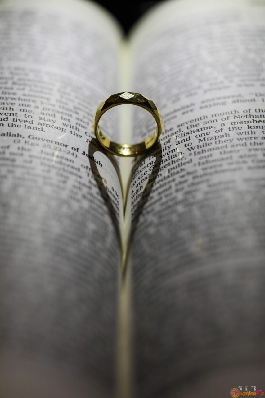 wedding ring in a book theme