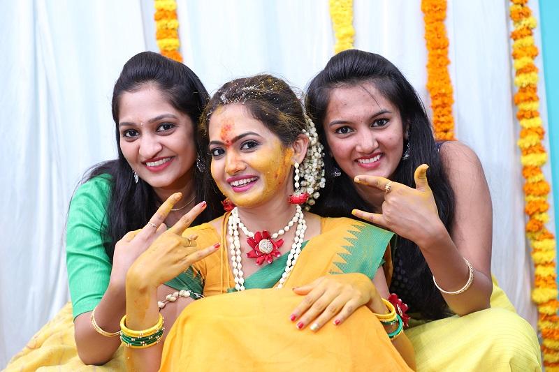 bride with her bridesmaids for haldi ceremony-yellow wedding sari