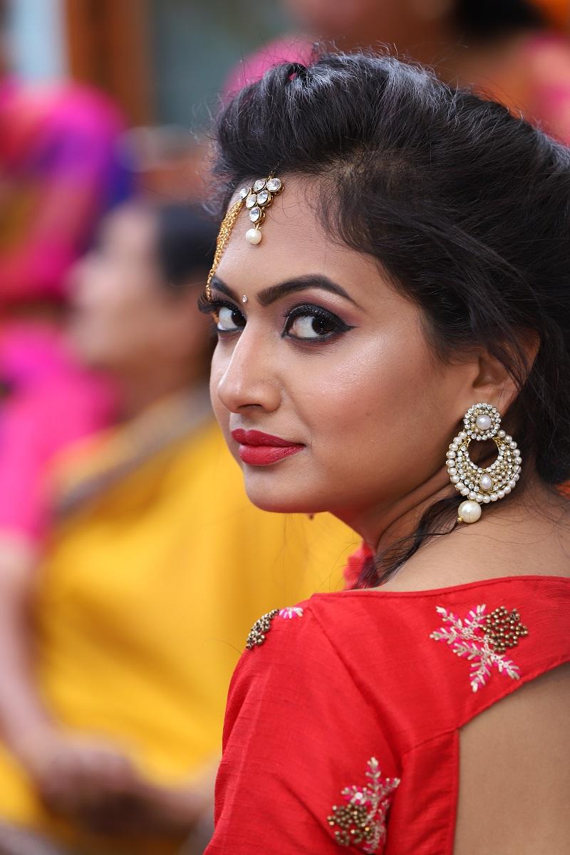 bride in red lehenga crop top choli