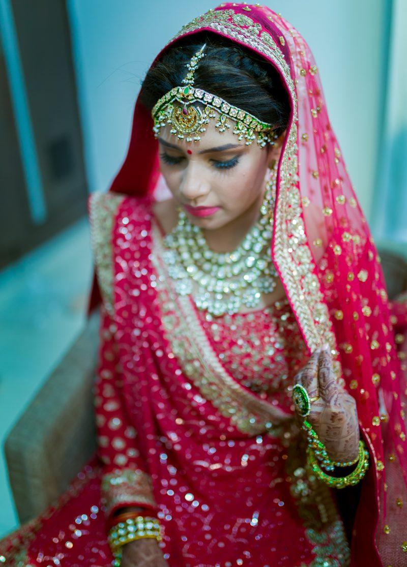 beautiful real wedding of twin sisters pink lehengas matching jewelry