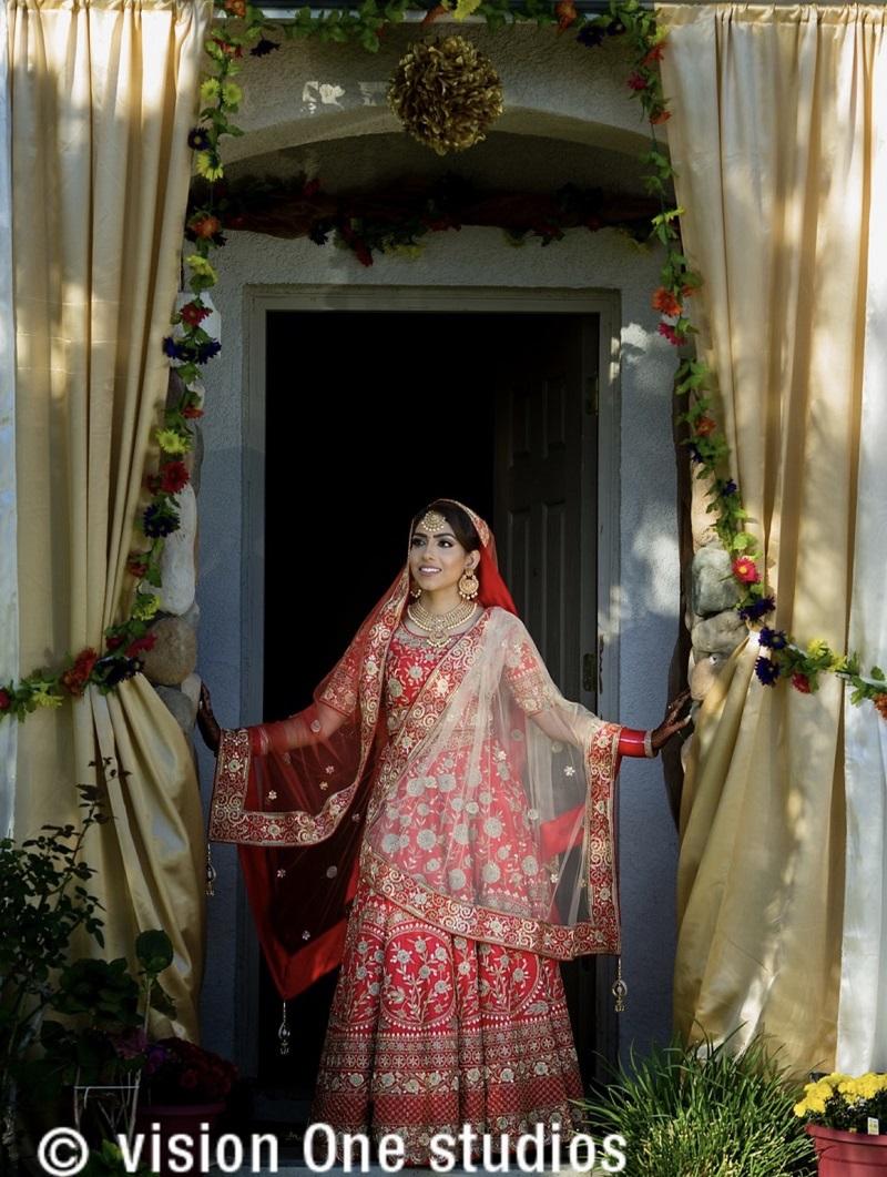 red lehenga beautiful Sikh wedding by Vision One Studios