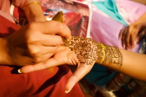 indian-wedding-bride-getting-henna-applied-5233770